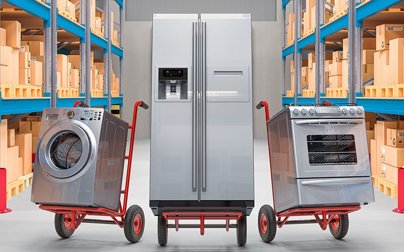 appliances sitting on handtrucks